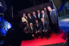 Regroupement des anciens Canadiens de Montréal dans un studio de photos aménagé pour prendre les invités en photo